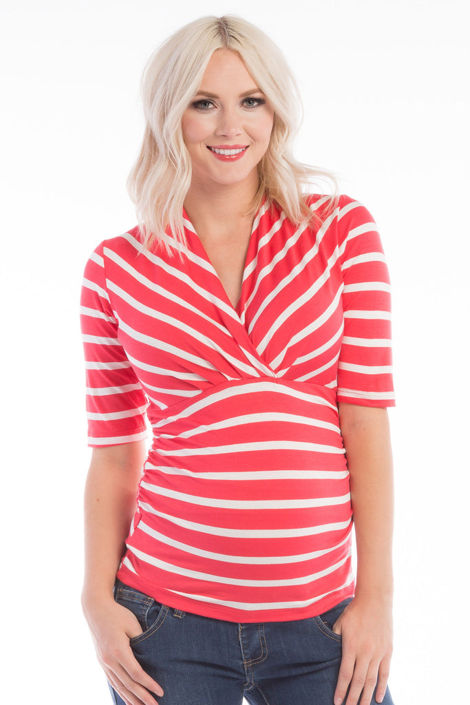 The Coral/Ivory Stripe Megan Top is a stylish, surplice neckline with soft stretchy fabric, and ruching at the sides. It is nursing friendly. A great top before, during, and after pregnancy.