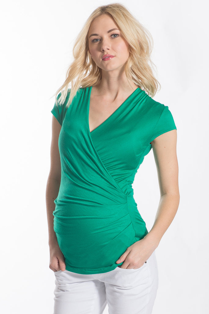 The Green Karen top has pleating along the side makes it flattering to your midsection. Made from only the softest fabric, you'll want a Karen Top in every color! The cross-over neckline is nursing friendly making it the perfect top before, during, and after pregnancy.