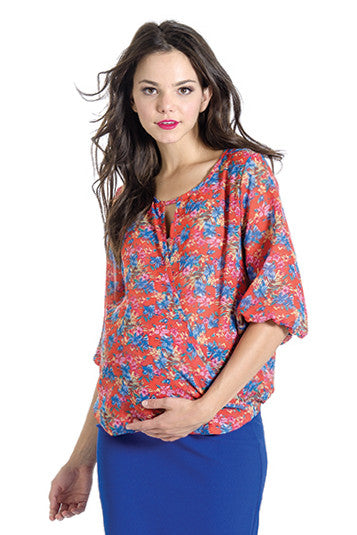 The Kylie Top in Floral Print is a wrap top with a keyhole and hook closure in the front.  It is nursing friendly.  Perfect for women, pregnancy women and nursing moms.
