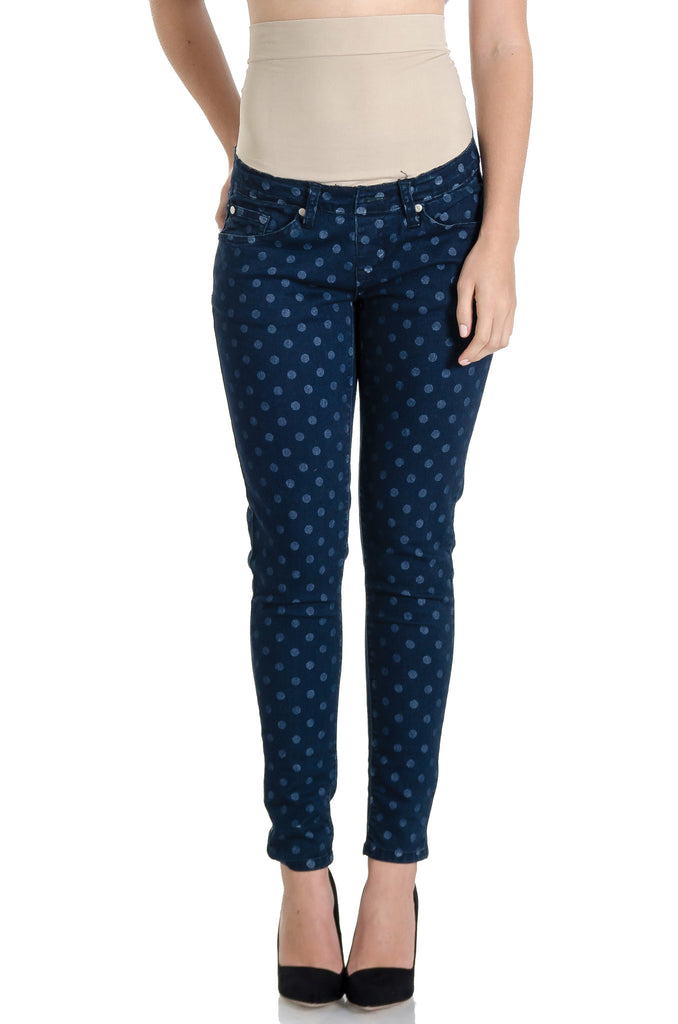 Dark wash and polka dot skinny jeans with belly band that works for figure-shaping or maternity.