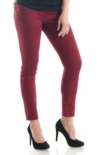 Burgundy denim skinny jeans with belly band that works for figure-shaping or maternity.