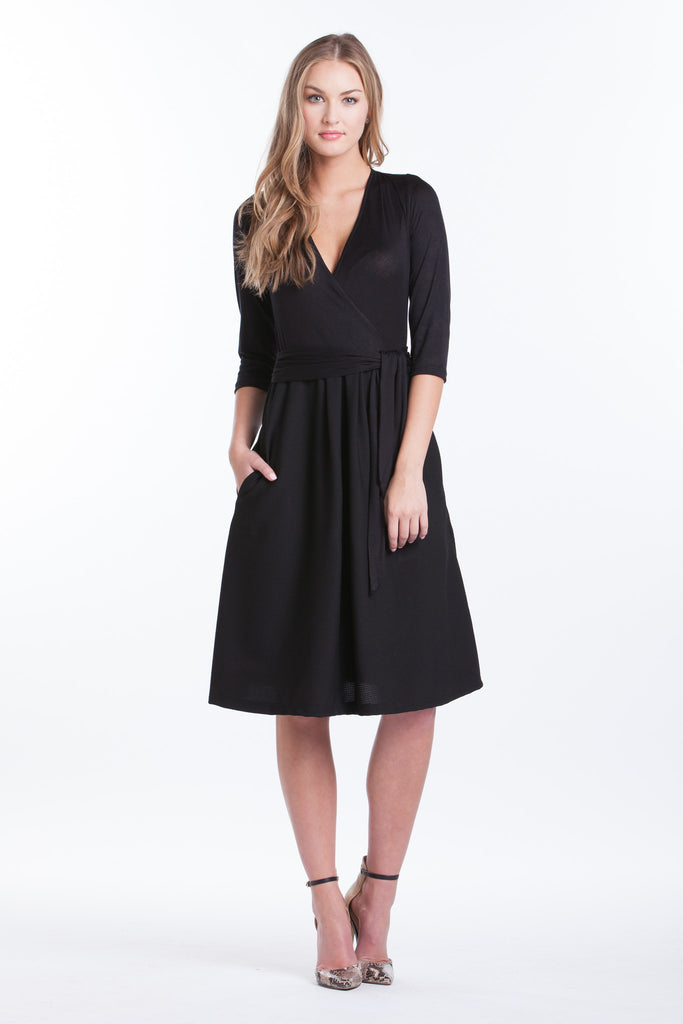 Black surplice belted dress with pockets.  The Abby Dress is an A-line dress with 3/4 length sleeves and pleats at the waist give a figure flattering line. Crossover neckline works great for nursing.  The material and cut make this dress work for women, maternity, and nursing.