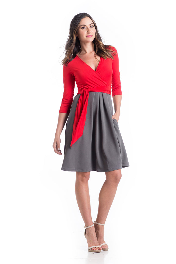 The Abby Dress with Tomato for the top and Grey for the skirt is an A-line dress with 3/4 length sleeves and pleats at the waist give a figure flattering line. Crossover neckline works great for nursing.  The material and cut make this dress work for women and maternity.