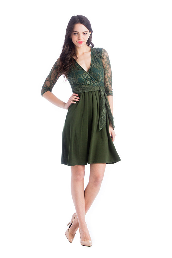 Hunter Green surplice belted dress with pockets.  The Abby Dress is an A-line dress with 3/4 length sleeves and pleats at the waist give a figure flattering line. Crossover neckline works great for nursing.  The material and cut make this dress work for women, maternity, and nursing.