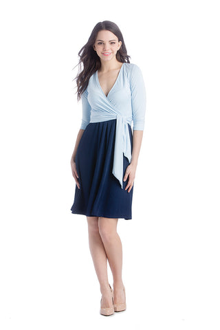 Powder Blue/Navy surplice belted dress with pockets.  The Abby Dress is an A-line dress with 3/4 length sleeves and pleats at the waist give a figure flattering line. Crossover neckline works great for nursing.  The material and cut make this dress work for women, maternity, and nursing.
