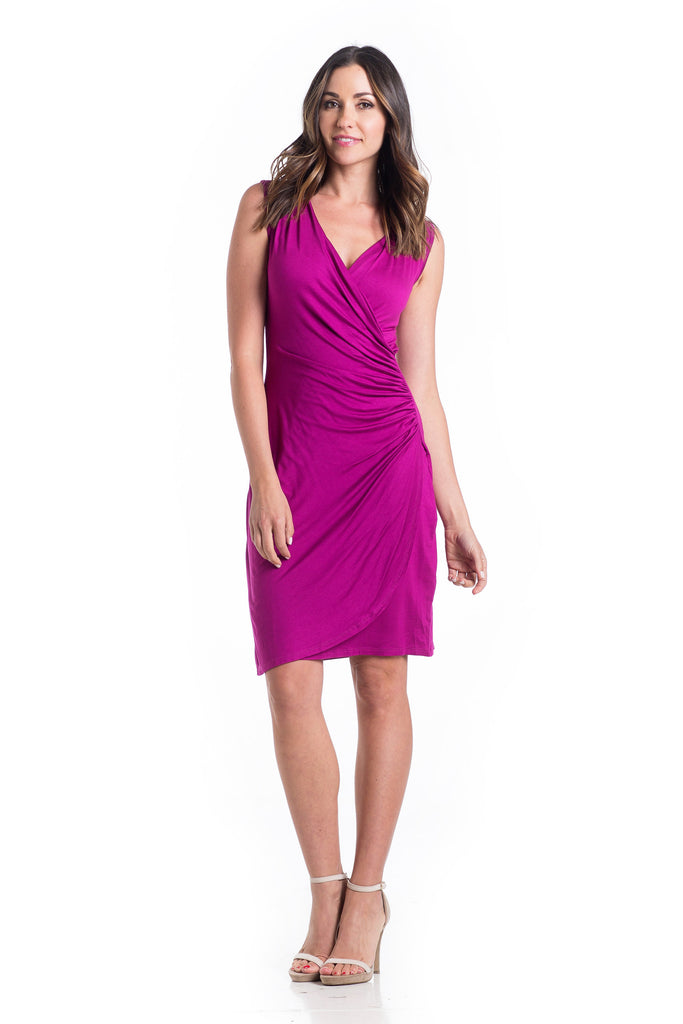 The Brynley Dress in Magenta is a faux-wrap dress with scoop-front hem and pleats along the side offer maximum flattery to the body making a great dress for women and maternity.  The cross-over neckline also works great for nursing.
