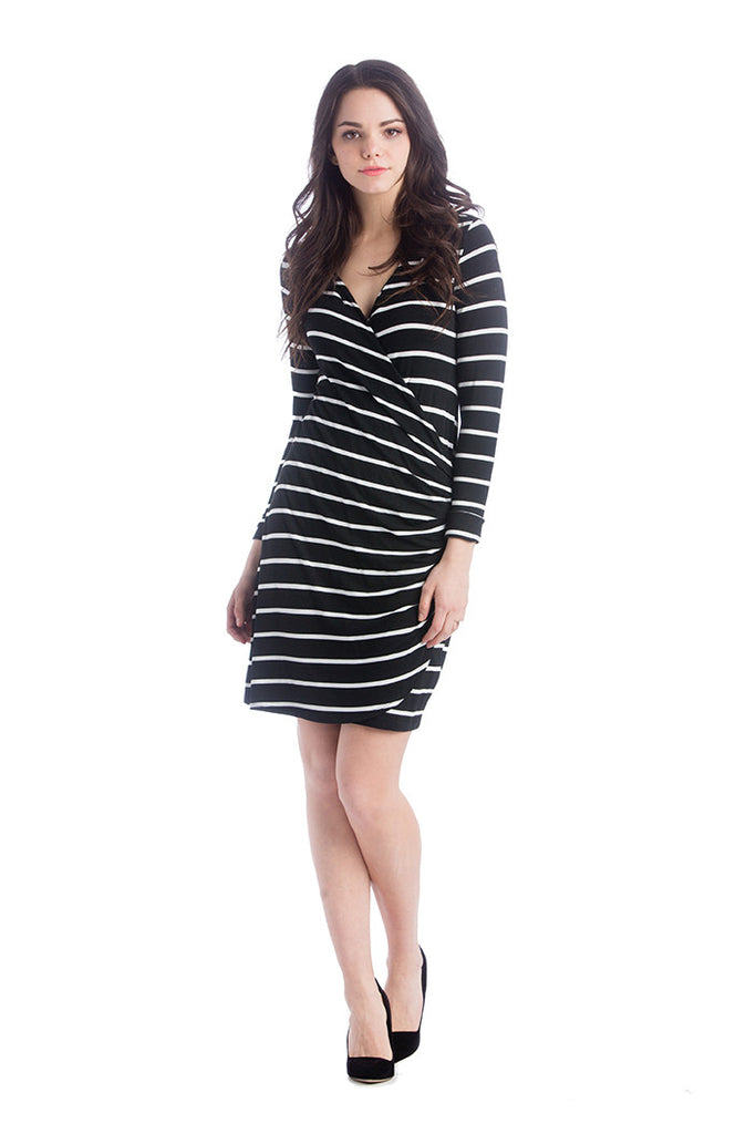 The Brynley Dress in Black and White Stripes is a faux-wrap dress with scoop-front hem and pleats along the side offer maximum flattery to the body making a great dress for women and maternity.  The cross-over neckline also works great for nursing.
