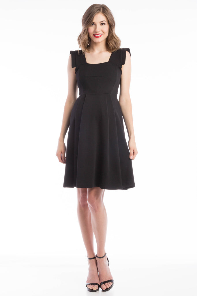 The Rachel Dress in Black is a classic 50's style dress with square neck and perfectly placed style-lines give a structured look while being soft and feminine with straight capped sleeves.  The material and cut make this dress work for women and maternity.