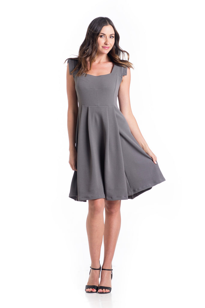 The Rachel Dress in Grey is a classic 50's style dress with square neck and perfectly placed style-lines give a structured look while being soft and feminine with straight capped sleeves.  The material and cut make this dress work for women and maternity.