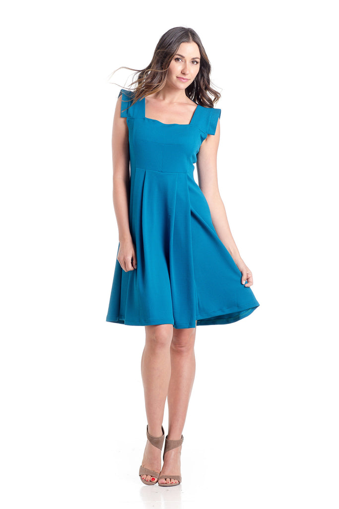 The Rachel Dress in Blue is a classic 50's style dress with square neck and perfectly placed style-lines give a structured look while being soft and feminine with straight capped sleeves.  The material and cut make this dress work for women and maternity.