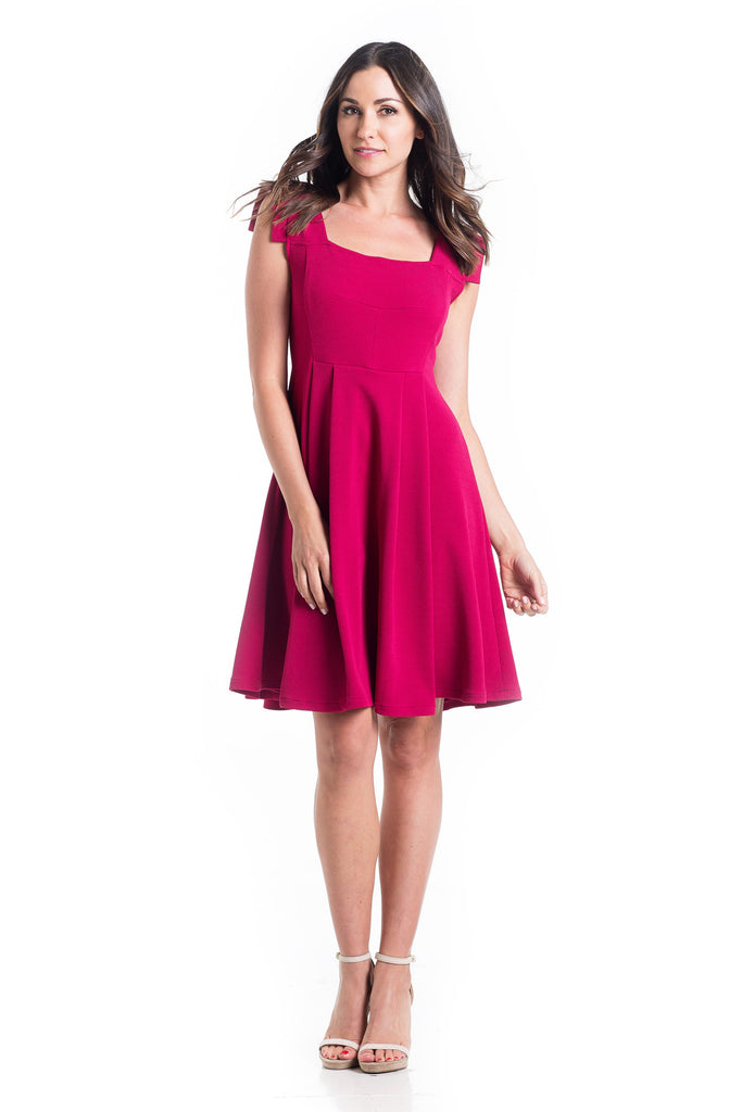 The Rachel Dress in Magenta is a classic 50's style dress with square neck and perfectly placed style-lines give a structured look while being soft and feminine with straight capped sleeves.  The material and cut make this dress work for women and maternity.