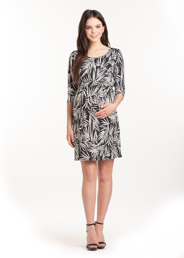 The Black and White Leaf Print Shift Dress is an above-the-knee dress is cinched at the waist with a belt to accentuate the hourglass figure. The scoopneck, long sleeves and beautiful pattern are feminine and flattering. Style is designed to wear before, during and after pregnancy.