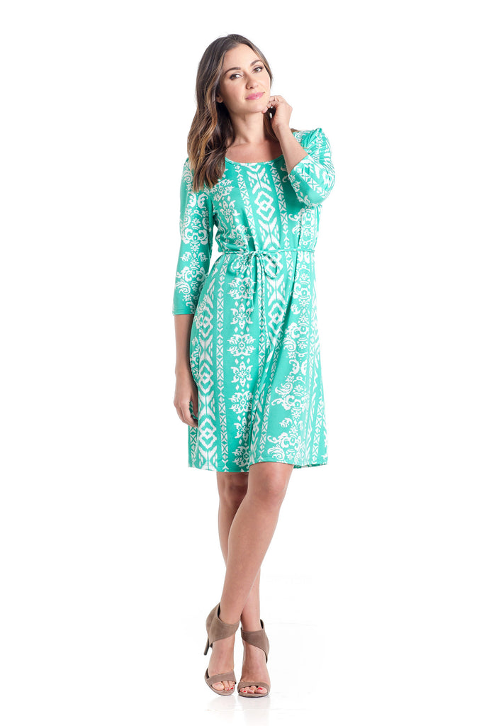 Shift dress in Teal Ikat design is an above-the-knee dress is cinched at the waist with a belt.  The material and cut work for women and maternity.