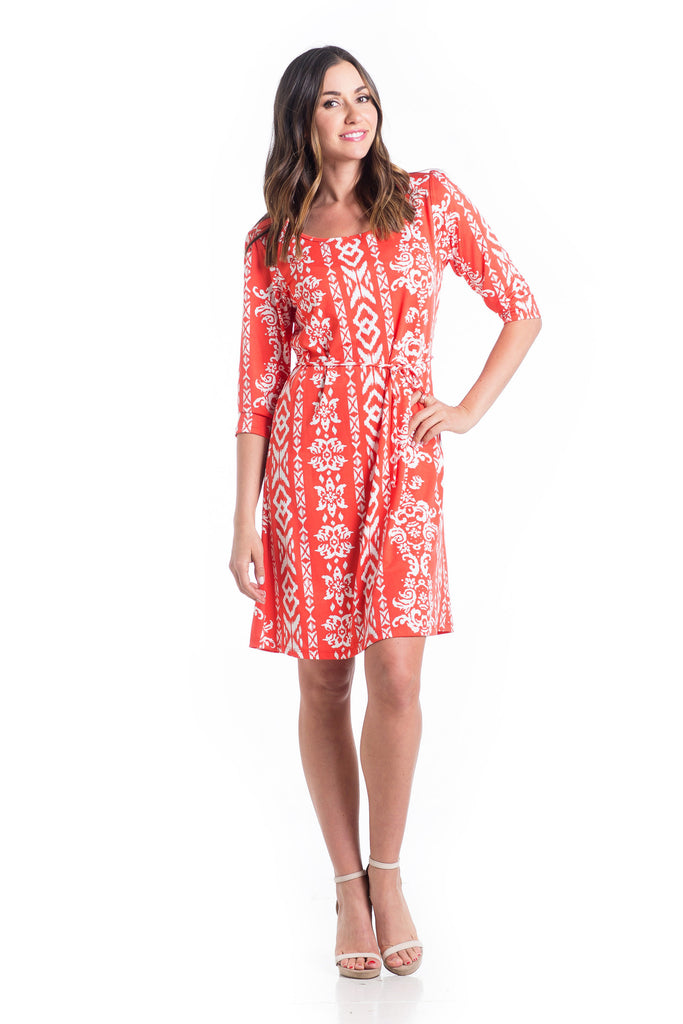 Shift dress in Tomato Ikat design is an above-the-knee dress is cinched at the waist with a belt.  The material and cut work for women and maternity.