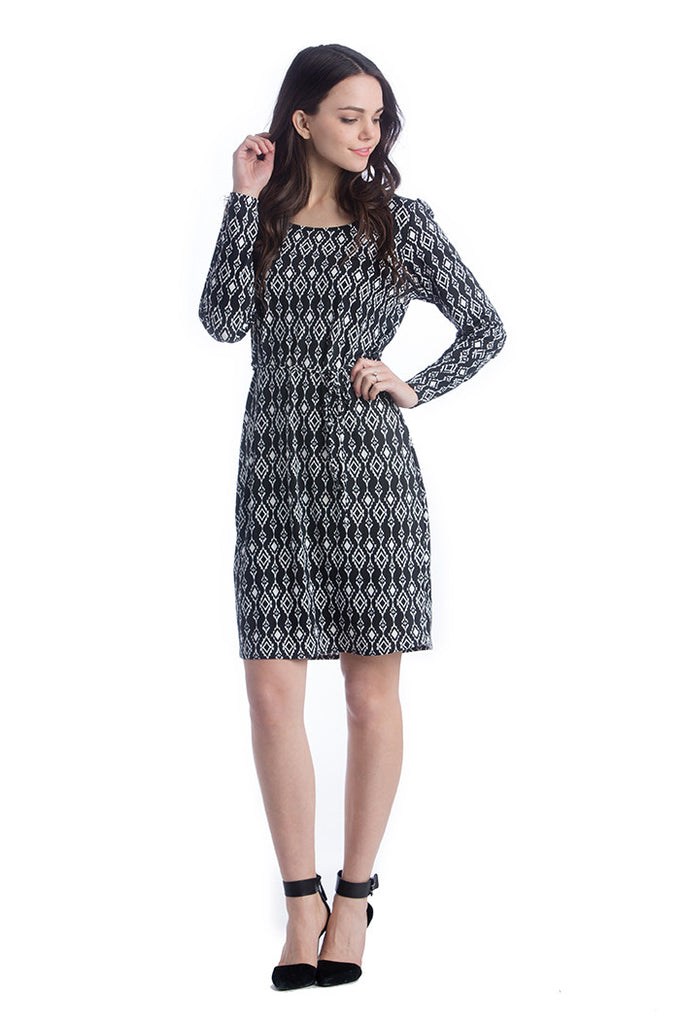 The Black/White Ikat Print Shift Dress is an above-the-knee dress is cinched at the waist with a belt to accentuate the hourglass figure. The scoopneck, long sleeves and beautiful pattern are feminine and flattering. Style is designed to wear before, during and after pregnancy.