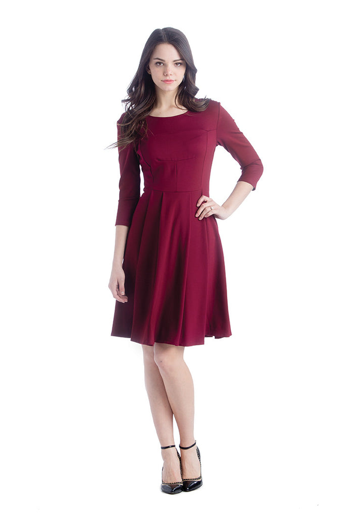 The McCall Dress in Marsala Red is a A-line cut with hem above the knee and quarter length sleeves.  It is perfect women and pregnancy.