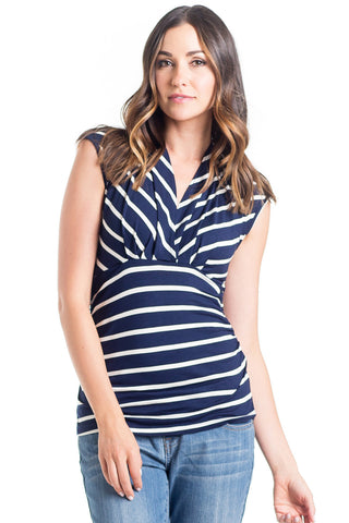 The Megan Top in Navy Ivory Stripe has a surplice neckline with capped sleeves, soft stretchy fabric, and ruching at the sides making it perfect for women, pregnancy, and nursing.