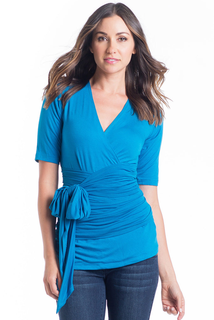 The Bella Top in Blue is a wrap top with an adjustable neckline, it shows just enough to keep it sexy without showing too much and is great for nursing. The wrap accentuates or hides your midsection as you please.  It is a great top for women and maternity.