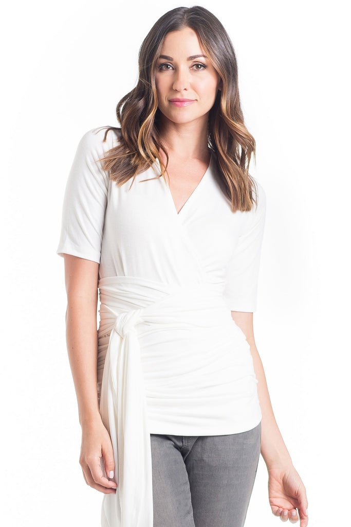 The Bella Top in Ivory is a wrap top with an adjustable neckline, it shows just enough to keep it sexy without showing too much and is great for nursing. The wrap accentuates or hides your midsection as you please.  It is a great top for women and maternity.