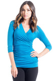 The Michelle Top in Blue is a classic top that fits beautifully on every body type! Featuring a cross-over neckline, soft stretchy fabric, and ruching at the side that is great for women, pregnancy and nursing.