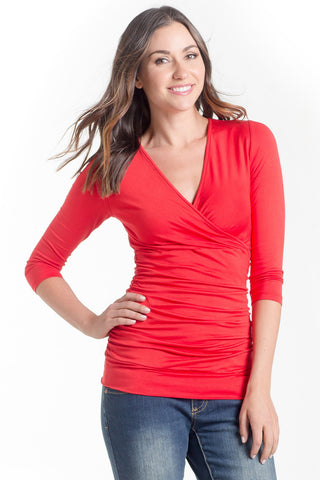 The Michelle Top in Tomato is a classic top that fits beautifully on every body type! Featuring a cross-over neckline, soft stretchy fabric, and ruching at the side that is great for women, pregnancy and nursing.