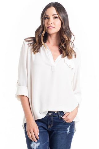 The Dani Top in Ivory is light chiffon collared blouse with a high-low hemline and button detail make this top a chic and flattering for women and maternity.