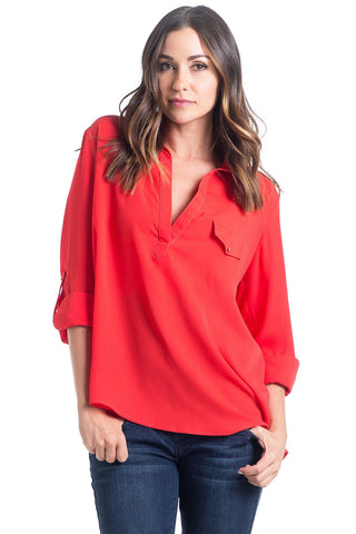 The Dani Top in Tomato is light chiffon collared blouse with a high-low hemline and button detail make this top a chic and flattering for women and maternity.