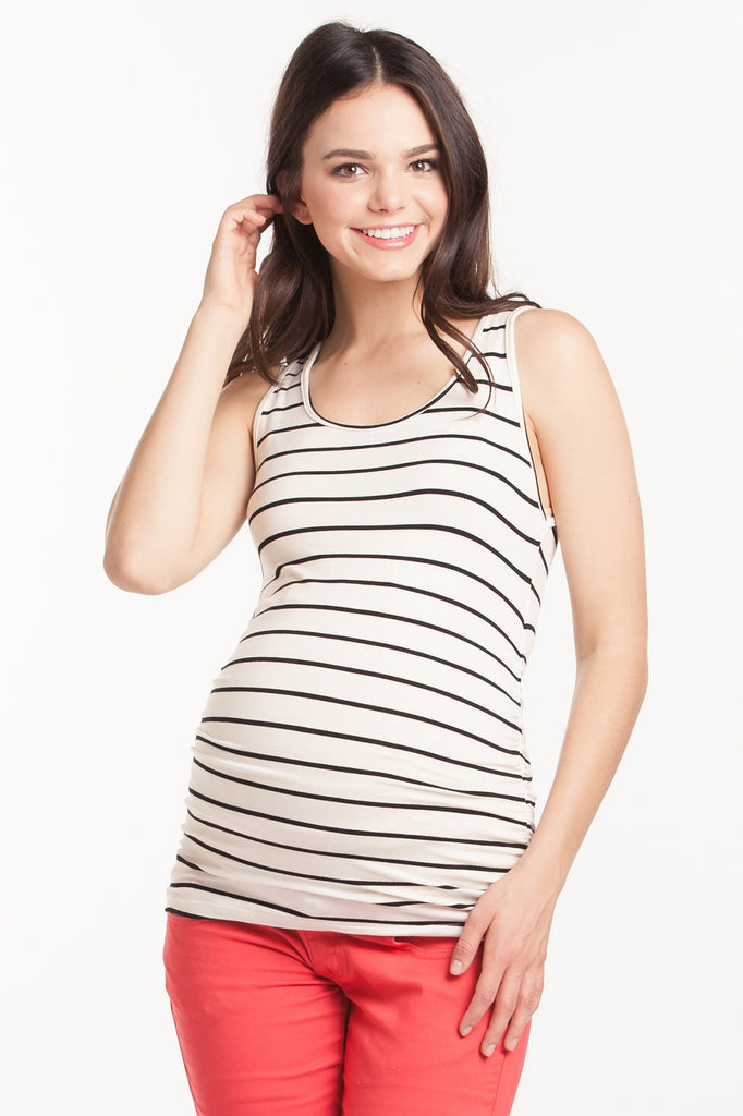 The Ivory Black Stripe Tank can be worn alone or under any top to add coverage! Tank sleeves are cut to hide any bra strap yet flatter those pretty shoulders! Side ruching provides extra support and a little extra flair! Style is designed to wear before, during and after pregnancy.