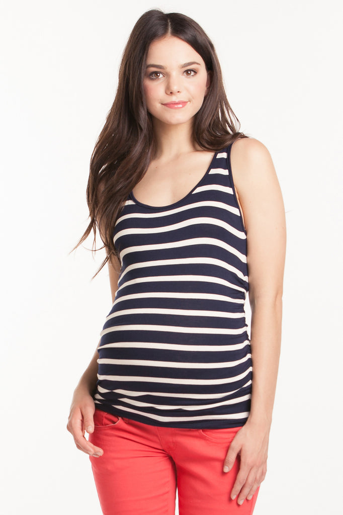 The Navy Ivory Stripe Tank can be worn alone or under any top to add coverage! Tank sleeves are cut to hide any bra strap yet flatter those pretty shoulders! Side ruching provides extra support and a little extra flair! Style is designed to wear before, during and after pregnancy.