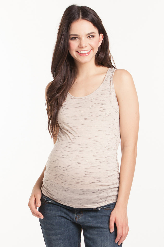 The Oatmeal Slub Tank can be worn alone or under any top to add coverage! Tank sleeves are cut to hide any bra strap yet flatter those pretty shoulders! Side ruching provides extra support and a little extra flair! Style is designed to wear before, during and after pregnancy.
