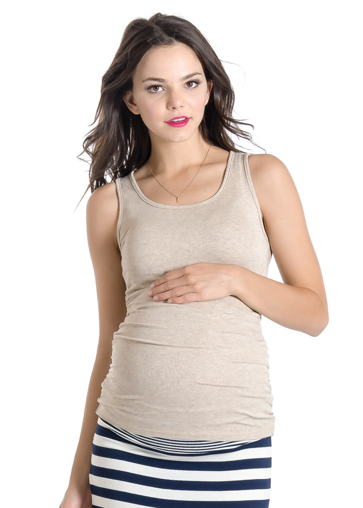 The Wheat Beige Tank can be worn alone or under any top to add coverage! Tank sleeves are cut to hide any bra strap yet flatter those pretty shoulders! Side ruching provides extra support and a little extra flair! Style is designed to wear before, during and after pregnancy.