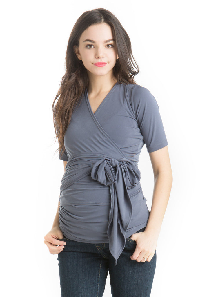 The Dark Grey Bella Top has an adjustable neckline, it shows just enough to keep it sexy without showing too much and is great for nursing. The wrap accentuates or hides your midsection as you please. Tip: Hide back bumps by puckering the material to your body's desire. The Bella Top is perfect before, during, and after pregnancy.