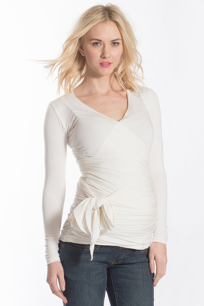 The Ivory White Bella Top has an adjustable neckline, it shows just enough to keep it sexy without showing too much and is great for nursing. The wrap accentuates or hides your midsection as you please. Tip: Hide back bumps by puckering the material to your body's desire. The Bella Top is perfect before, during, and after pregnancy.
