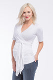 The White Short Sleeves Bella Top has an adjustable neckline, it shows just enough to keep it sexy without showing too much and is great for nursing. The wrap accentuates or hides your midsection as you please. Tip: Hide back bumps by puckering the material to your body's desire. The Bella Top is perfect before, during, and after pregnancy.