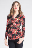 The Black and Red Print Karen top has pleating along the side makes it flattering to your midsection. Made from only the softest fabric, you'll want a Karen Top in every color! The cross-over neckline is nursing friendly making it the perfect top before, during, and after pregnancy.