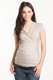 The Grey/Peach Stripes Karen top has pleating along the side makes it flattering to your midsection. Made from only the softest fabric, you'll want a Karen Top in every color! The cross-over neckline is nursing friendly making it the perfect top before, during, and after pregnancy.