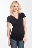 The Black Michelle Top is a classic top that fits beautifully on every body type! Featuring a cross-over neckline that is great for nursing, soft stretchy fabric, and ruching at the sides. The Michelle Top is great before, during, and after pregnancy.