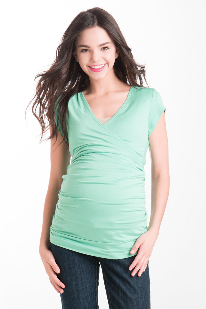 The Mint Green Michelle Top is a classic top that fits beautifully on every body type! Featuring a cross-over neckline that is great for nursing, soft stretchy fabric, and ruching at the sides. The Michelle Top is great before, during, and after pregnancy.