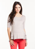 The Morgan Top in Silver is a peplum top.  It is perfect for women and pregnancy.