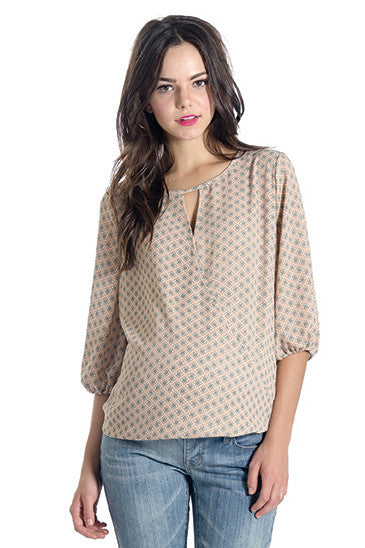 The Kylie Top in Almond Medallion Beige Print is a wrap top with a keyhole and hook closure in the front.  It is nursing friendly.  Perfect for women, pregnancy women and nursing moms.