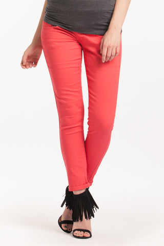 The Colored Skinny Jeans in Coral Red have a belly band that is great for smoothing the midsection or support during pregnancy.