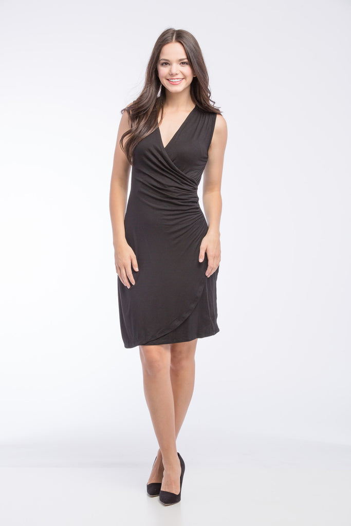 The Brynley Dress in Black Sleeveless is a faux-wrap dress with scoop-front hem and pleats along the side offer maximum flattery to the body making a great dress for women and maternity.  The cross-over neckline also works great for nursing.