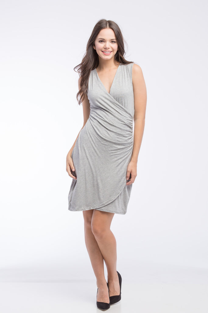 The Brynley Dress in Grey Sleeveless is a faux-wrap dress with scoop-front hem and pleats along the side offer maximum flattery to the body making a great dress for women and maternity.  The cross-over neckline also works great for nursing.