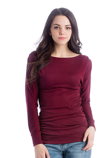 The Taylor Top in Marsala Sweater is a dark red, boatneck blouse with ruching on the sides and kimono-style sleeves.  It is perfect for women and pregnancy.