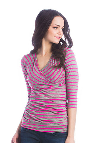 The Fuchsia Pink/Grey Stripe Michelle Top is a classic top that fits beautifully on every body type! Featuring a cross-over neckline that is great for nursing, soft stretchy fabric, and ruching at the sides. The Michelle Top is great before, during, and after pregnancy.
