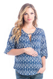 The Kylie Top in Navy/White Ikat Print is a wrap top with a keyhole and hook closure in the front.  It is nursing friendly.  Perfect for women, pregnancy women and nursing moms.