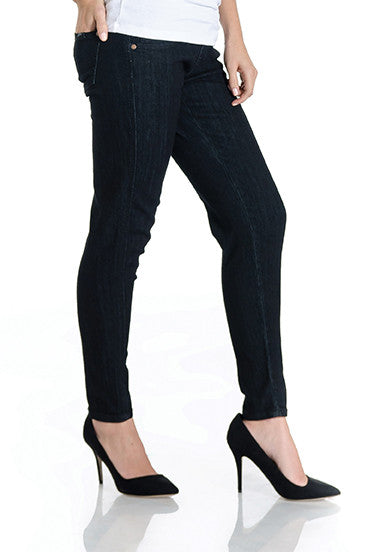 Black denim skinny jeans with belly band that works for figure-shaping or maternity.