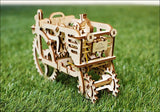 wooden mechanical tractor model on a grass