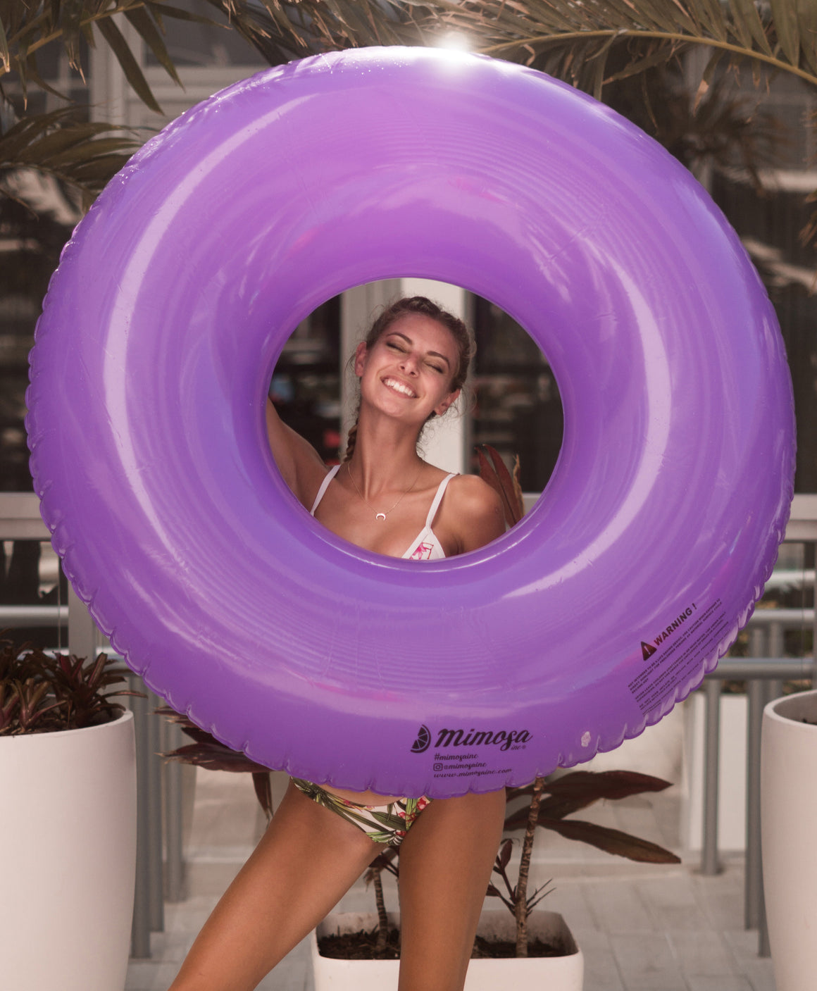 Purple solid color round tube pool float by Mimosa Inc