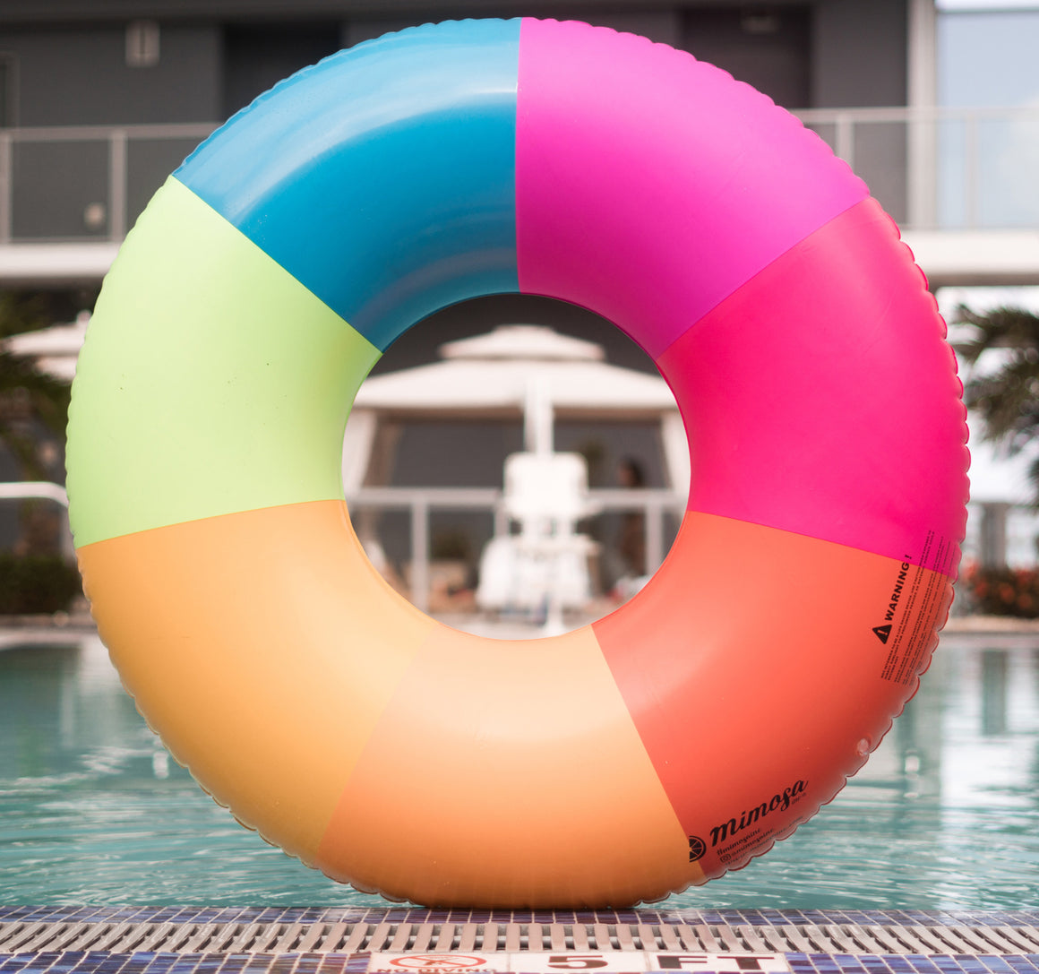 Rainbow pattern pool float by Mimosa Inc